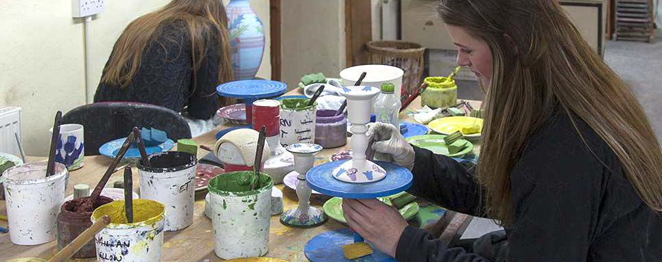 Hand painting the pottery